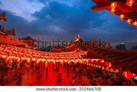 KUALA LUMPUR, MALAYSIA - FEBRUARY 23, 2015: Tourists visit the scenic Thean Hou Temple at night with hundreds of lanterns hung across the courtyard celebrating the lunar Chinese New Year. - stock photo