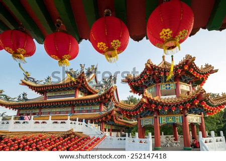 KUALA LUMPUR, MALAYSIA - FEBRUARY 08, 2015: Tourists visit the scenic Thean Hou Temple with hundreds of lanterns hung across the courtyard. This is in preparation for the coming Chinese New Year. - stock photo