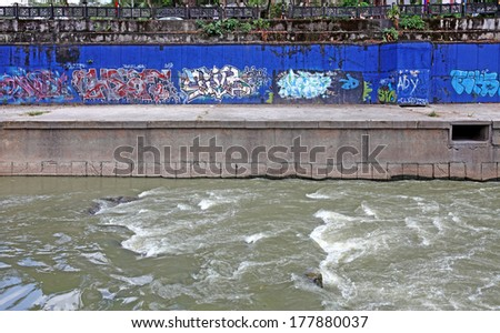 KUALA LUMPUR, MALAYSIA - FEBRUARY 16, 2014: Urban graffiti along Klang River by street artists endorsed by Kuala Lumpur City Hall to create street art for the KUL SIGN 2012 festival in Kuala Lumpur.