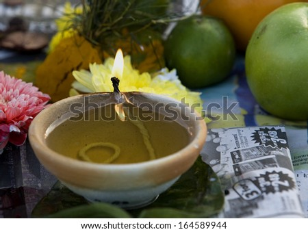 Kuala Lumpur, Malaysia, January 27 2013: A candle lights on the altar during Thaipusam festival to fulfill their vows and offer thanks to the deities. - stock photo