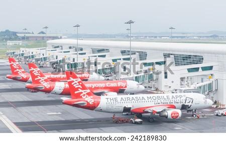 Kuala Lumpur, Malaysia - January 5, 2015. Aircraft of Air asia are parking and preparing to flying at Kuala Lumpur International Airport on Jan 5, 2015 - stock photo