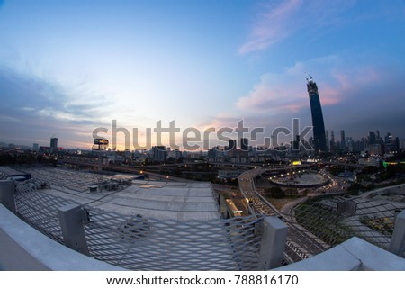 KUALA LUMPUR, MALAYSIA - 7 January 2018: Dramatic scenery of sunset at Kuala Lumpur city with new skyscraper under construction in Tun Razak Exchange. The image contain soft focus, noise and grain.