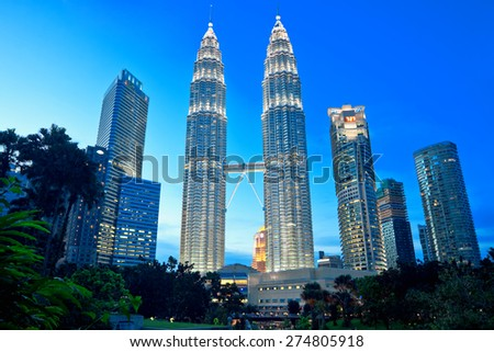 KUALA LUMPUR, MALAYSIA - JANUARY 17: Petronas Twin Towers at day on January 17, 2014 in Kuala Lumpur. Petronas Twin Towers were the tallest buildings (452 m) in the world from 1998 to 2004 - stock photo