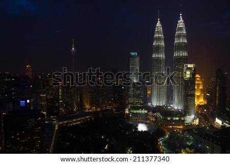 KUALA LUMPUR, MALAYSIA - JANUARY 26: Petronas Twin Towers at night on January 26, 2014 in Kuala Lumpur. Petronas Twin Towers most famous shopping center in Kuala Lumpur - stock photo