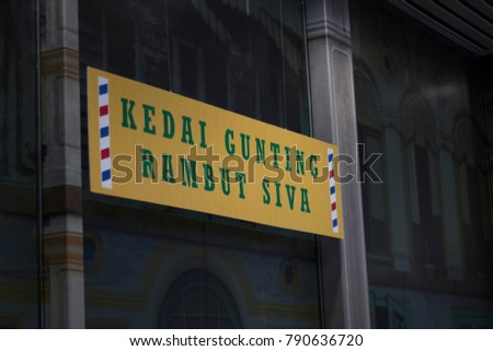 Kuala Lumpur, Malaysia - January 5, 2018: Signboards of old shop (Siva Barber Shop) at the Kuala Lumpur International Airport (KLIA) for public exhibition.