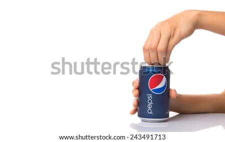 KUALA LUMPUR, MALAYSIA - JANUARY 12TH, 2015. Opening a can of Pepsi . Pepsi is a carbonated soft drink produced and manufactured by PepsiCo Inc. an American multinational food and beverage company.