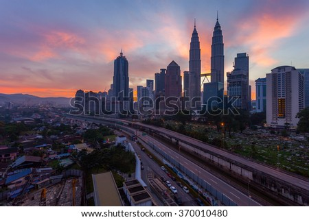 Kuala Lumpur, Malaysia - January 31 2016: The KLCC Twin Towers is being silhouetted during sunrise.
