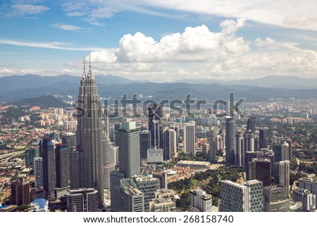 Kuala Lumpur, Malaysia - January 5, 2015: View of the Petronas Twin Towers in Kuala Lumpur, Malaysia on January 5, 2015. The Petronas Towers were the tallest buildings in the world from 1998 to 2004. - stock photo