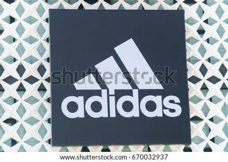 KUALA LUMPUR, MALAYSIA - JULY 2, 2017: Adidas logo. Adidas is a German multinational corporation, headquartered in Herzogenaurach, Germany, designs and manufactures shoes, clothing and accessories.