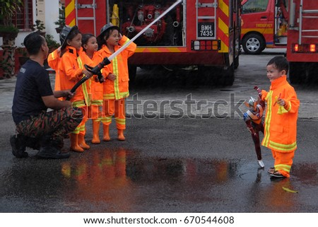"Kuala Lumpur, Malaysia - July 1, 2017 : Kids from pre-school attending fire fighting course. The ""Bomba Cilik"" is a sosial programe initiated by Malaysia Fire Department or Jabatan Bomba."