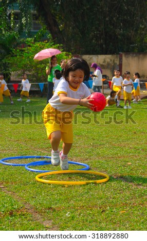 KUALA LUMPUR, MALAYSIA, 28 JULY 2013 : Kindergarten children competing in jumping ball race during their annual sport day.