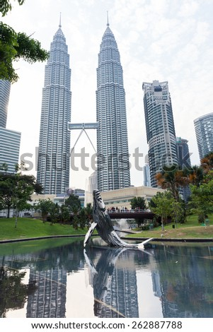 Kuala Lumpur, Malaysia - 23 July 2014: Modern sculpture in KLCC Park and Petronas Twin Towers on the background on 23 July 2014, Kuala Lumpur, Malaysia. - stock photo