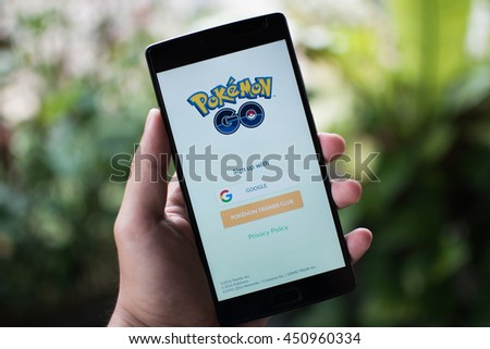 KUALA LUMPUR, MALAYSIA - 12 JULY 2016: Pokemon Go is a free-to-play, GPS based augmented reality mobile game developed by Niantic for iOS and Android devices - stock photo