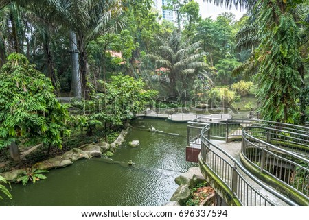 "Kuala Lumpur,Malaysia - July 31,2017 : Scenic view of the Kuala Lumpur Bird Park, it is also well known as ""World's Largest Free-flight Walk-in Aviary""."