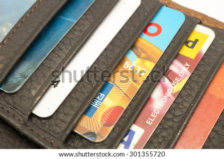 KUALA LUMPUR, MALAYSIA - JULY 30th 2015. Multiple card inside the wallet. Having more than 1 credit card, the more temptation there is to use them.  - stock photo