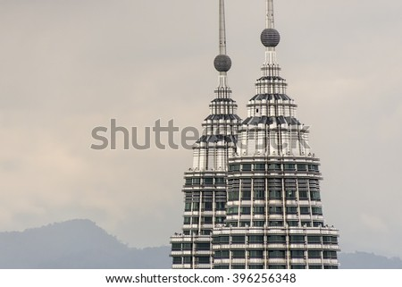 KUALA LUMPUR, MALAYSIA - JULY 7, 2012: The Petronas Towers in Kuala Lumpur is the tallest structure in Asia, and one of the city's most popular visitor attractions. - stock photo