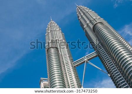 KUALA LUMPUR,MALAYSIA - JULY 11, 2009: The Petronas Towers,Petronas Twin Towers are twin skyscrapers in Kuala Lumpur, Malaysia. Malaysia.Malaysia is a member of Asean Economic Community (AEC) - stock photo
