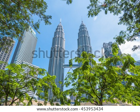 KUALA LUMPUR, MALAYSIA - 12 JULY 2016: The Petronas Twin Towers photo taken during sunny afternoon from KLCC park.
