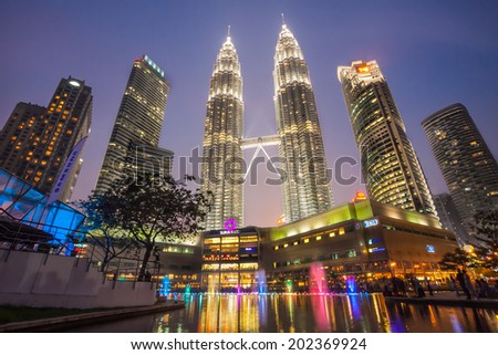 KUALA LUMPUR, MALAYSIA - JUNE 25: Colourful fountain show of Petronas Twin Towers on JUNE 25, 2014,They were the tallest building in the world 1998-2004 in Kuala Lumpur Malaysia  - stock photo