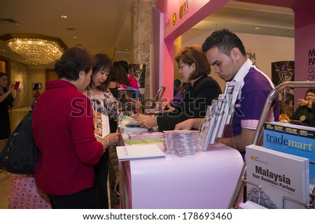 KUALA LUMPUR, MALAYSIA-JUNE 6,2013:Participant visited Malaysia booth in exhibition during Global Summit of Women 2013 in Kuala Lumpur, Malaysia on June 6, 2013.