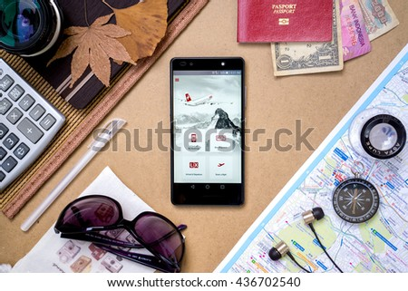 KUALA LUMPUR, MALAYSIA - JUNE 14TH, 2016: Modern lifestyle with smartphone to stay connected & browsing using favourite Apps. Book & Check-in flight with SWISS Airlines Apps.