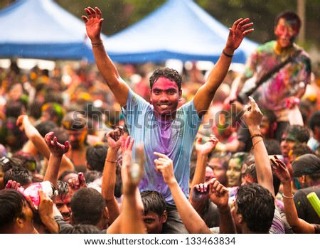 KUALA LUMPUR, MALAYSIA - MAR 31: People celebrated Holi Festival of Colors, Mar 31, 2013 in Kuala Lumpur, Malaysia. Holi, marks the arrival of spring, being one of the biggest festivals in Asia. - stock photo
