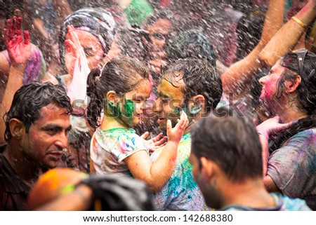 KUALA LUMPUR, MALAYSIA - MAR 31: Unidentified child during Holi Festival of Colors, Mar 31, 2013 in Kuala Lumpur, Malaysia. Holi marks the arrival of spring, being one of the biggest festivals in Asia - stock photo