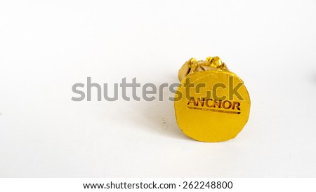 Kuala Lumpur, Malaysia - March 21, 2015 : Anchor beer logo on the base plate of golden statue. For almost a decade, Anchor Beer was the dominate beer on Hainan Island. - stock photo
