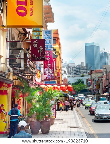 KUALA LUMPUR, MALAYSIA - MARCH 20, 2012: Busy Chinatown street in KL. Kuala Lumpur is the capital and most populous city in Malaysia. City covers an area of 243 km2 and has  population of 1.6 million