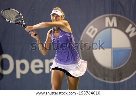 Kuala Lumpur, Malaysia, March 02 2013: Czech Karolina Pliskova returns a shot to  Japan's Ayumi Morita during the semi final match of the WTA Malaysian Open tennis tournament.