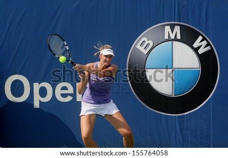 Kuala Lumpur, Malaysia, March 02 2013: Czech Karolina Pliskova returns a shot to  Japan's Ayumi Morita during the semi final match of the WTA Malaysian Open tennis tournament. - stock photo