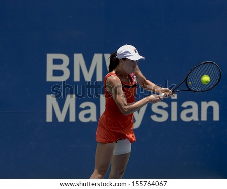 Kuala Lumpur, Malaysia, March 02 2013: Jelena Jankovic of Serbia returns a shot during the semi final match against Petra Martic of Croatia at the WTA Malaysian Open tennis tournament.