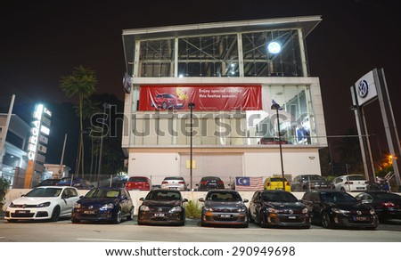 KUALA LUMPUR, MALAYSIA - MARCH 20 : Line up of Volkswagen GTI cars in-front of the Showroom on March 20, 2015 in Kuala Lumpur, Malaysia.  - stock photo