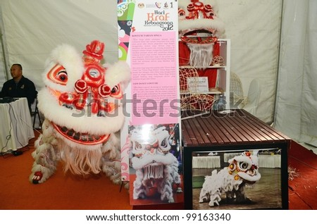 KUALA LUMPUR, MALAYSIA - MARCH 30: Lion dance equipment and accessories on display during National Craft Day 2012 at the Kuala Lumpur Craft Complex on March 30, 2012 in Kuala Lumpur, Malaysia - stock photo