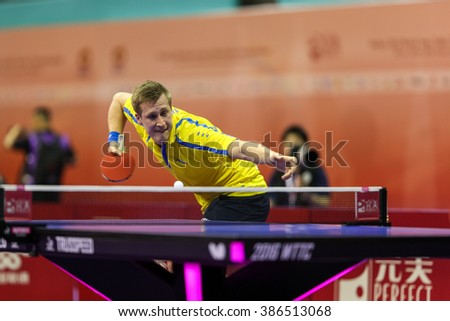 KUALA LUMPUR, MALAYSIA - MARCH 01, 2016: Mattias Karlsson of Sweden plays a return shot in his match in the Perfect 2016 World Team Table-tennis Championships held in Kuala Lumpur, Malaysia. - stock photo