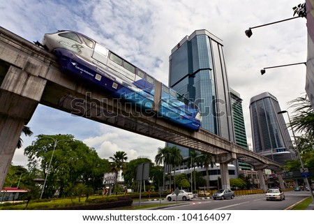 KUALA LUMPUR, MALAYSIA - MARCH 3: Monorail train on March 3, 2012 in Kuala Lumpur.  KL Monorail opened on 31 August 2003, and serves 11 stations running 8.6 km
