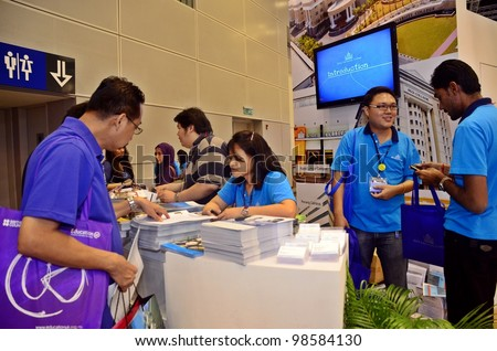 KUALA LUMPUR, MALAYSIA - MARCH 17:SEGI University College promote the exhibition during the Falcon Education Fair 2012 at Kuala Lumpur Convention Centre (KLCC) March 17, 2010 in Kuala Lumpur. - stock photo