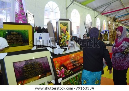 KUALA LUMPUR, MALAYSIA - MARCH 30: souvenir items sold by exhibitors staff  during National Craft Day 2012 at the Kuala Lumpur Craft Complex on March 30, 2012 in Kuala Lumpur, Malaysia - stock photo