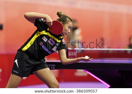 KUALA LUMPUR, MALAYSIA - MARCH 01, 2016: Tamolwan Khetkhuan of Thailand serves the ball in her match in the Perfect 2016 World Team Table-tennis Championships held in Kuala Lumpur, Malaysia.
