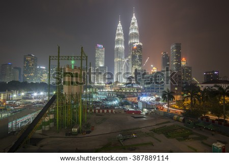 Kuala Lumpur, Malaysia - March 7, 2016: The Petronas Twin Tower and construction surrounding it during the night