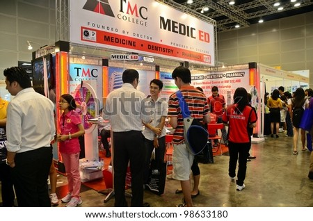 KUALA LUMPUR, MALAYSIA - MARCH 17: TMC College promote the exhibition during the Falcon Education Fair 2012 at Kuala Lumpur Convention Centre (KLCC) March 17, 2012 in Kuala Lumpur. - stock photo