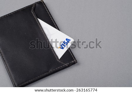 KUALA LUMPUR, MALAYSIA- MARCH 24, 2015: VISA card in black leather wallet - stock photo