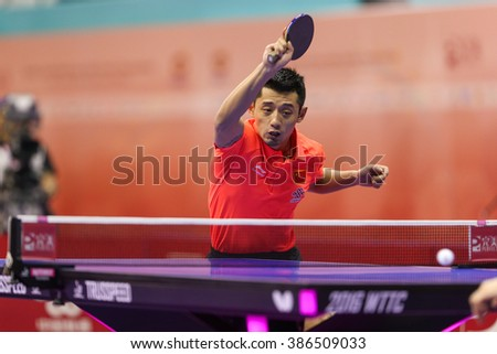 KUALA LUMPUR, MALAYSIA - MARCH 01, 2016: Zhang Jike of China smashes the the ball in his match in the Perfect 2016 World Team Table-tennis Championships held in Kuala Lumpur, Malaysia.
