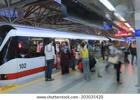 KUALA LUMPUR MALAYSIA - 30 May, 2014:Commuters use LRT at KL Sentral station. KL Sentral is a major transport hub of Kuala Lumpur opened in 2001.  - stock photo