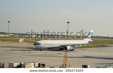KUALA LUMPUR, MALAYSIA - MAY 06, 2014: jet flight in airport. Kuala Lumpur International Airport (KLIA) is Malaysia's main international airport and one of the major airports of South East Asia