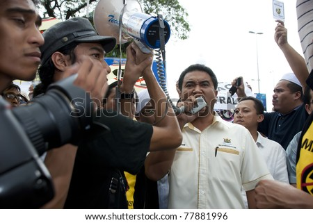 KUALA LUMPUR, MALAYSIA-MAY 20: Malaysian politician, Azmizam, joints a protest against a proposed rare earth plant to be built in Gebeng, in front of Petronas Twin Towers in Kuala Lumpur May 20, 2011.
