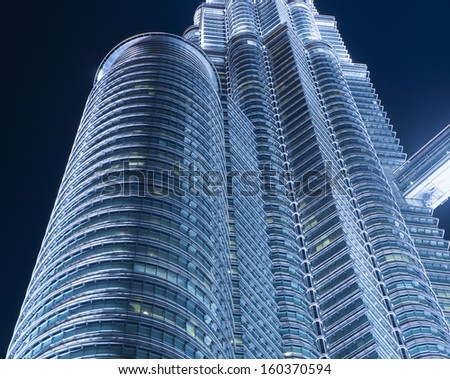 KUALA LUMPUR, MALAYSIA - MAY 3: Petronas Twin Towers exterior design on May 3, 2013 in Kuala Lumpur, Malaysia. These buildings are the most popular tourist attraction in Kuala Lumpur. - stock photo