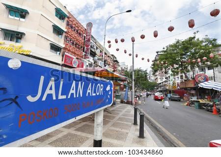 KUALA LUMPUR, MALAYSIA - MAY 16: Street sign of Jalan Alor on May 16, 2012 in Kuala Lumpur, Malaysia. Jalan Alor is a notorious red light district that is refurbished into a street food bazaar.