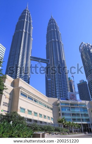 KUALA LUMPUR MALAYSIA - 25 May, 2014:SURIA KLCC Shopping Mall and Petronas twin towers. Petronas twin towers were a landmark of Kuala Lumpur and the tallest building in the world from 1998 to 2004  - stock photo