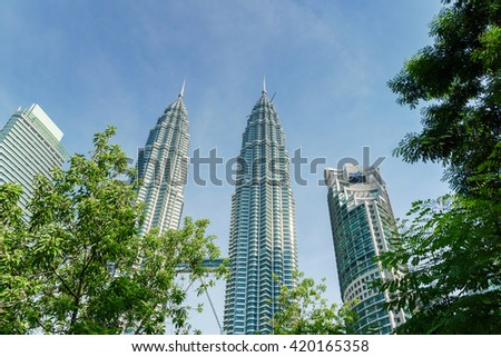 KUALA LUMPUR, MALAYSIA - MAY 07, 2016 : The Petronas Towers, also known as the Petronas Twin Towers, KLCC are twin skyscrapers in Kuala Lumpur, Malaysia.